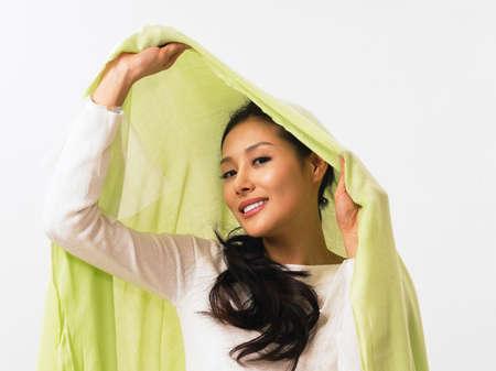 womanhood: Young woman wearing green shawl, portrait