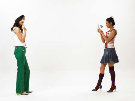 joyousness: Young women gesturing at each other