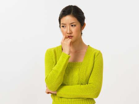 fair skin: Young woman contemplating, close-up LANG_EVOIMAGES