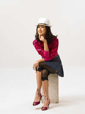 woman wearing hat: Young woman wearing hat, smiling