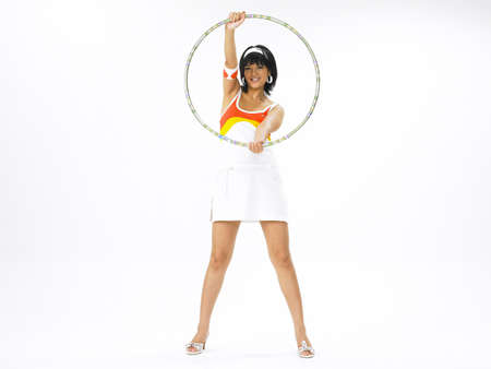 youthfulness: Portrait of a young woman with hula hoop
