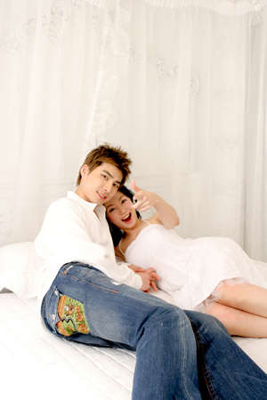 leisureliness: Young couple on bed