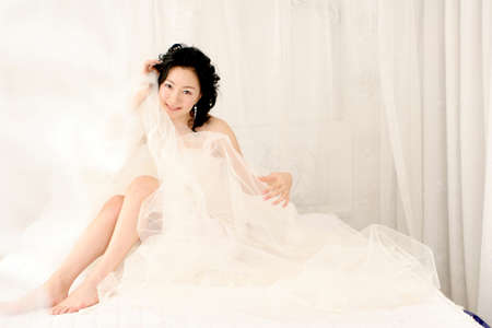 leisureliness: Young woman on bed