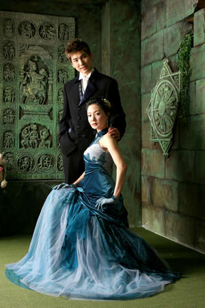 eveningwear: Young man and woman in eveningwear LANG_EVOIMAGES