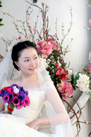 joyfulness: Bride holding bouquet