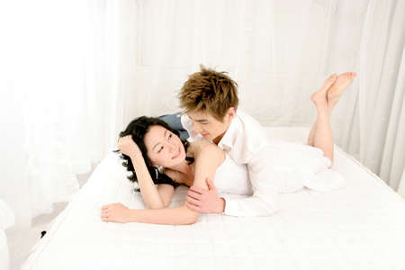 leisureliness: Young couple lying on bed