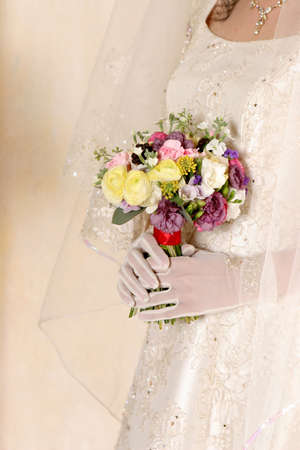 mid section: Bride holding bouquet, mid section