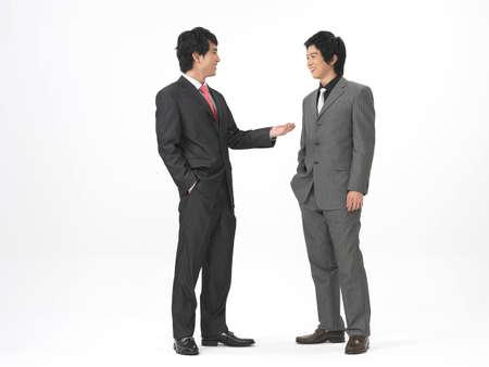 formal wear clothing: Business men smiling LANG_EVOIMAGES
