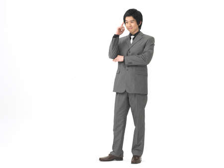formal wear clothing: Young businessman smiling