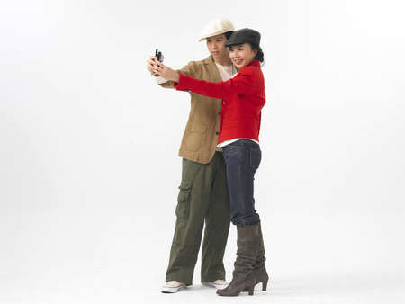 contentment: Young couple taking photo with cell phone