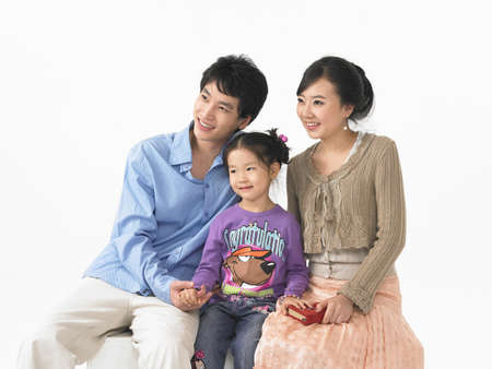 puerile: Parents with daughter against white background LANG_EVOIMAGES