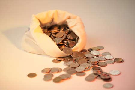 prosper: Coins spilling out of bag