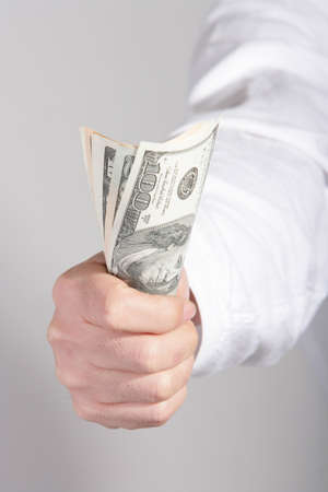 cropped off: Man holding money, close up