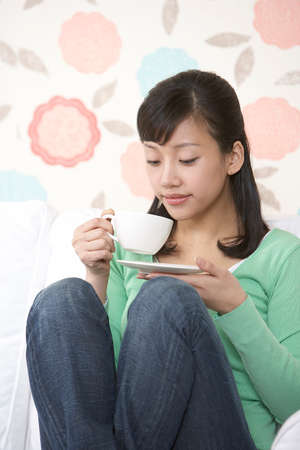 leisureliness: Young woman with cup of coffee