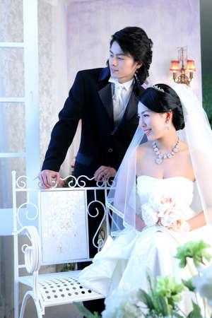 joyousness: Bride and groom looking away