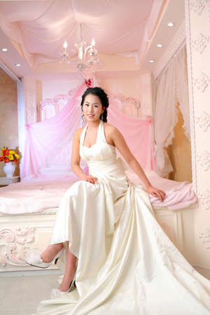 womanhood: Young woman in wedding dress