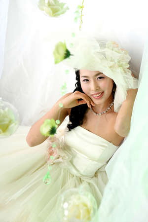 playfulness: Young woman in wedding dress