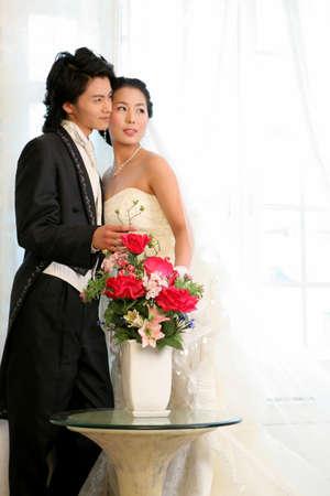 off the shoulder: Bride and groom embracing