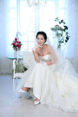 joyfulness: Young woman in wedding dress