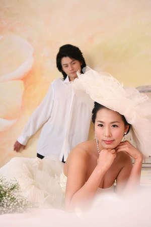 woman wearing hat: Woman wearing hat, man standing in background