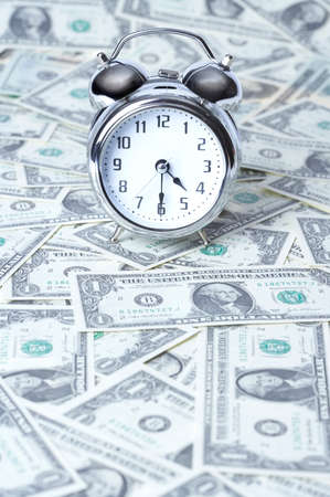 us paper currency: Alarm clock on US paper currency
