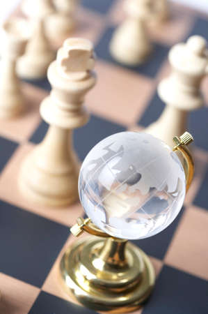 conversing: Chessboard with globe