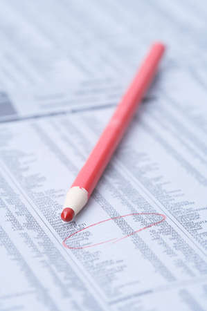 informing: Financial paper with colored pencil LANG_EVOIMAGES