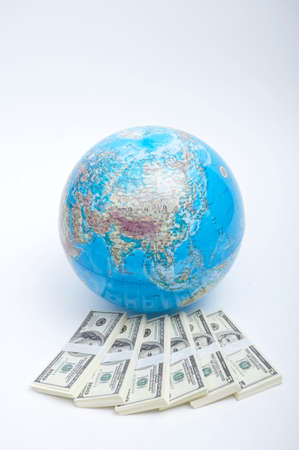 us paper currency: Globe with bundles of US paper currency LANG_EVOIMAGES