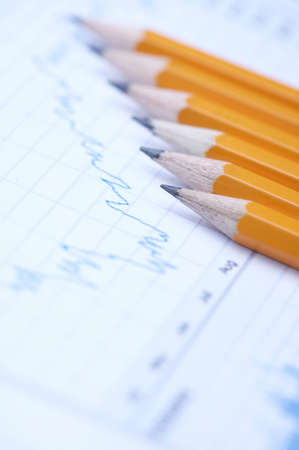 informing: Financial paper with pencil LANG_EVOIMAGES