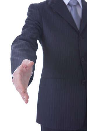 extending: Businessman extending hand to shake