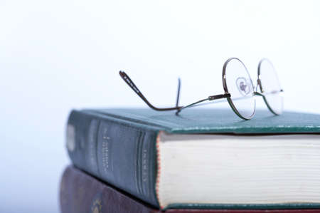 two objects: Close up of glasses on book LANG_EVOIMAGES