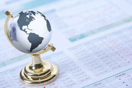 financial globe: Globe on financial paper