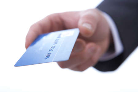 cropped shots: Businessman giving credit card, close up LANG_EVOIMAGES