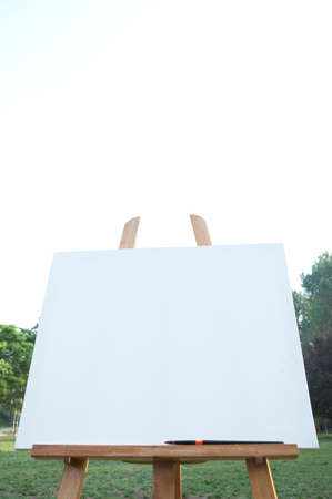 exhibiting: Easel with blank canvas, close-up