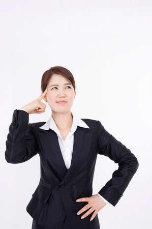 formal wear clothing: Portrait of a businesswoman contemplating with hand on hip