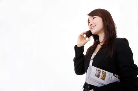 contentment: Businesswoman using mobile phone against white background LANG_EVOIMAGES