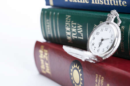alertness: Pocket watch with books, close-up