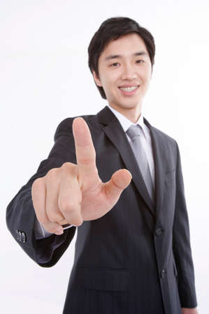 cheerfulness: Portrait of a businessman pointing finger LANG_EVOIMAGES