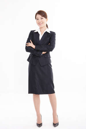 formals: Portrait of businesswoman standing with arms crossed