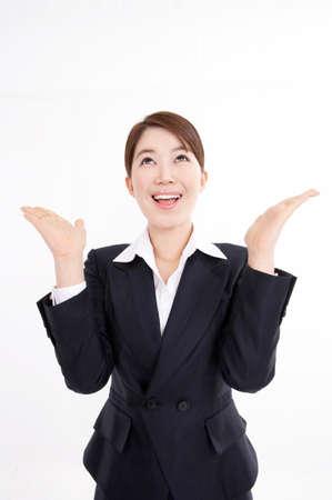 against white: Businesswoman gesturing against white background