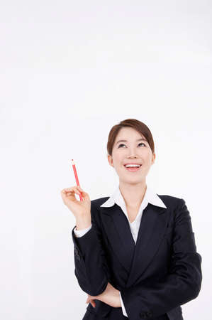 joyfulness: Portrait of a businesswoman holding pencil