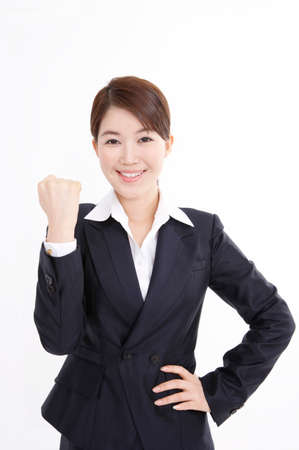 cheerfulness: Portrait of a businesswoman clenching fist LANG_EVOIMAGES