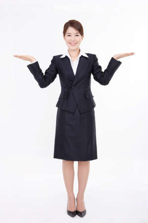 joyfulness: Portrait of a businesswoman gesturing against white background