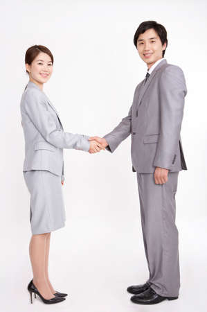 contentment: Portrait of a businessman and woman shaking hands LANG_EVOIMAGES