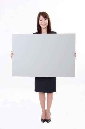 cheerfulness: Portrait of a smiling businesswoman holding blank card LANG_EVOIMAGES