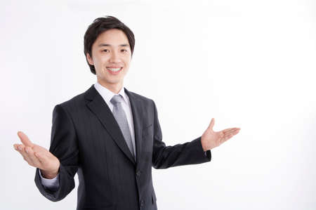 joyfulness: Portrait of a businessman gesturing against white background LANG_EVOIMAGES