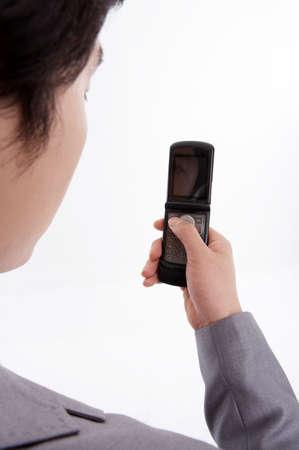 cropped shots: Businessman holding mobile phone LANG_EVOIMAGES