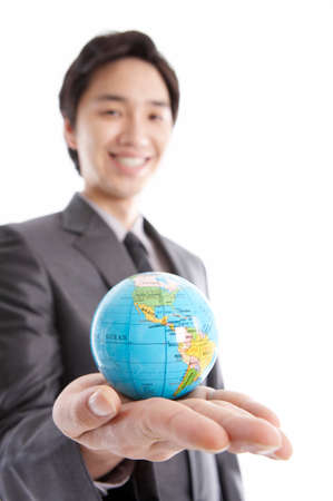 cropped shots: Cheerful young businessman holding globe