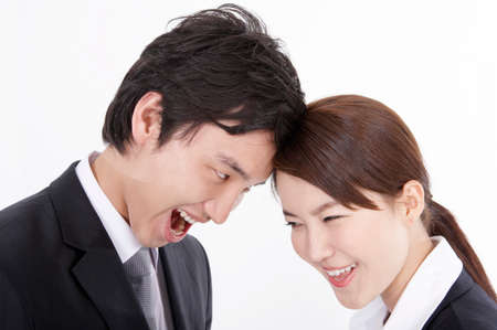 contentment: Cheerful young business couple standing face to face, smiling