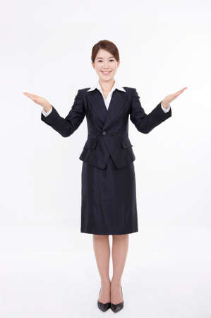 formal wear clothing: Young businesswoman gesturing